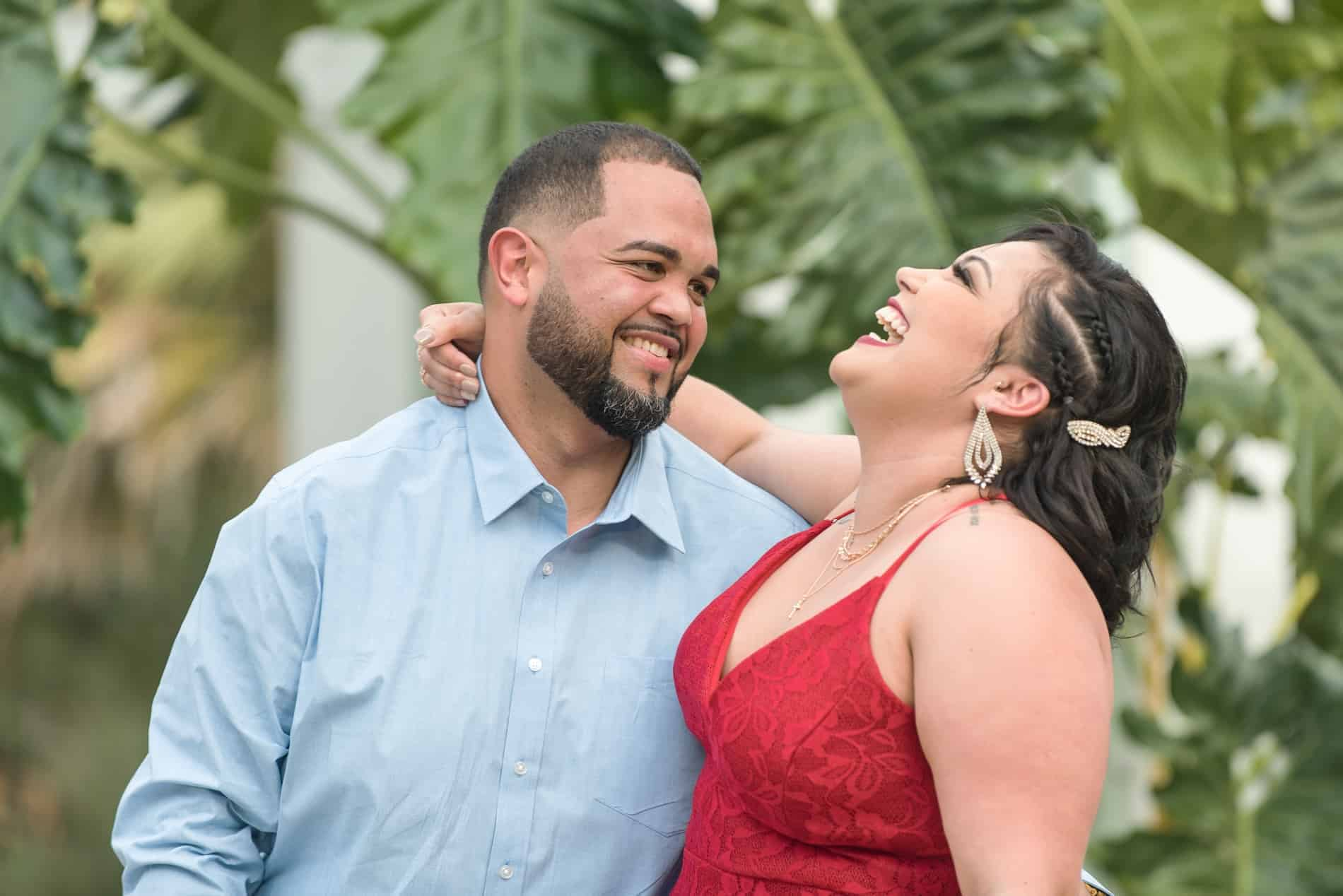 Couple laughing in their Leu Gardens Engagement Photos