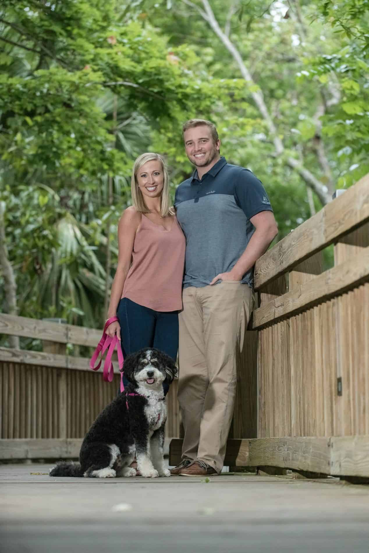 Couple walking their dog on the Boardwalk in Celebration