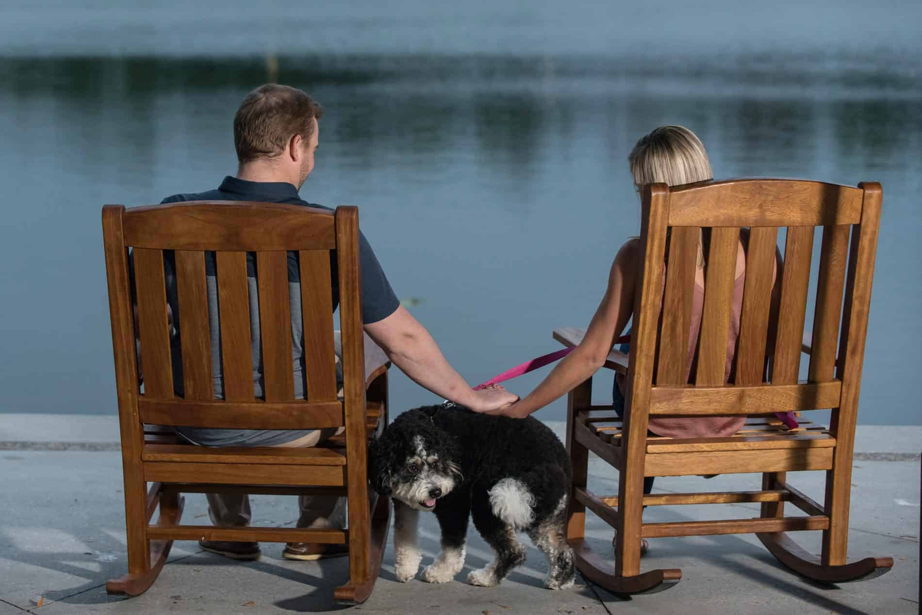 Couple sits by the lake in Celebration
