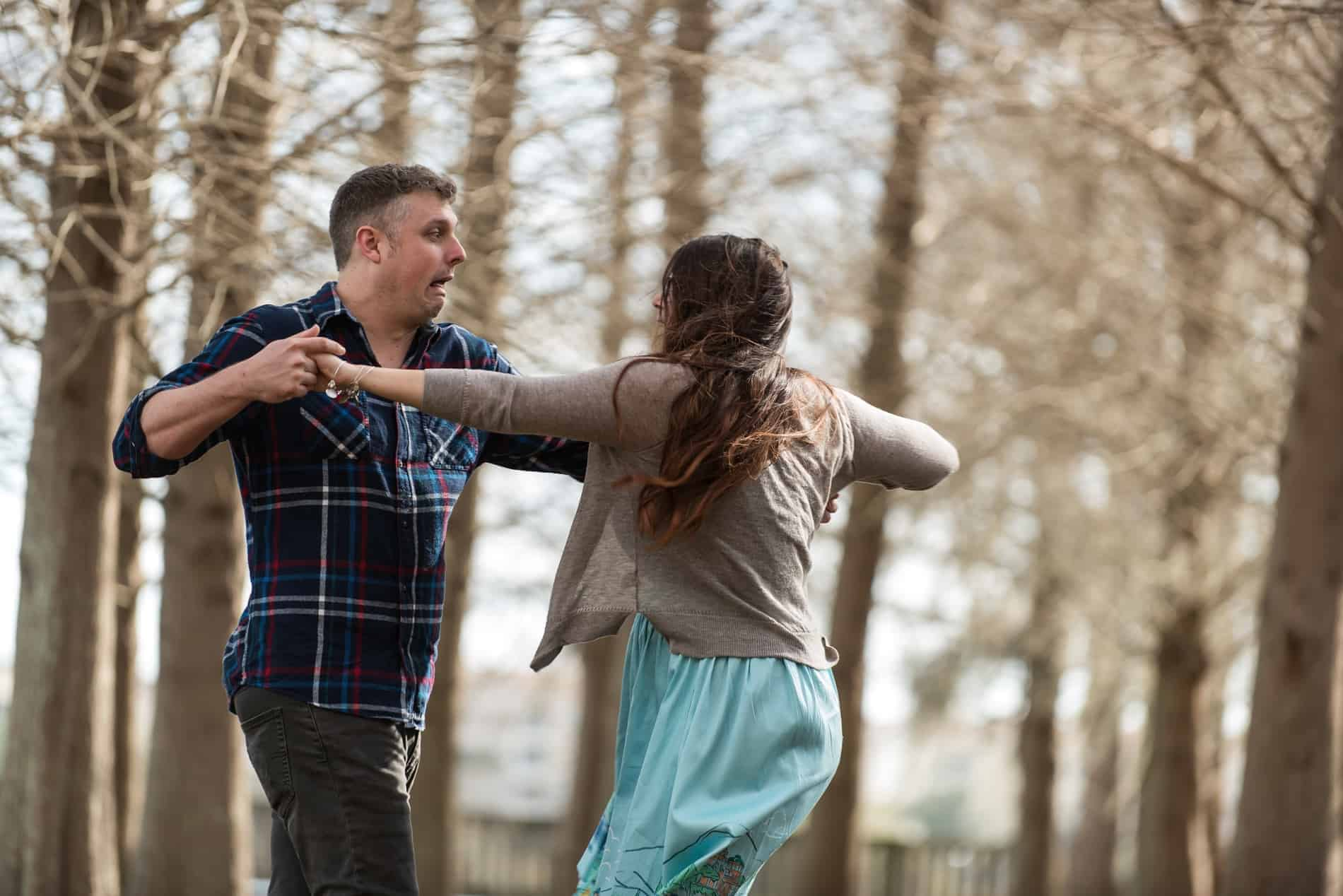 Engaged Couple dancing in the park