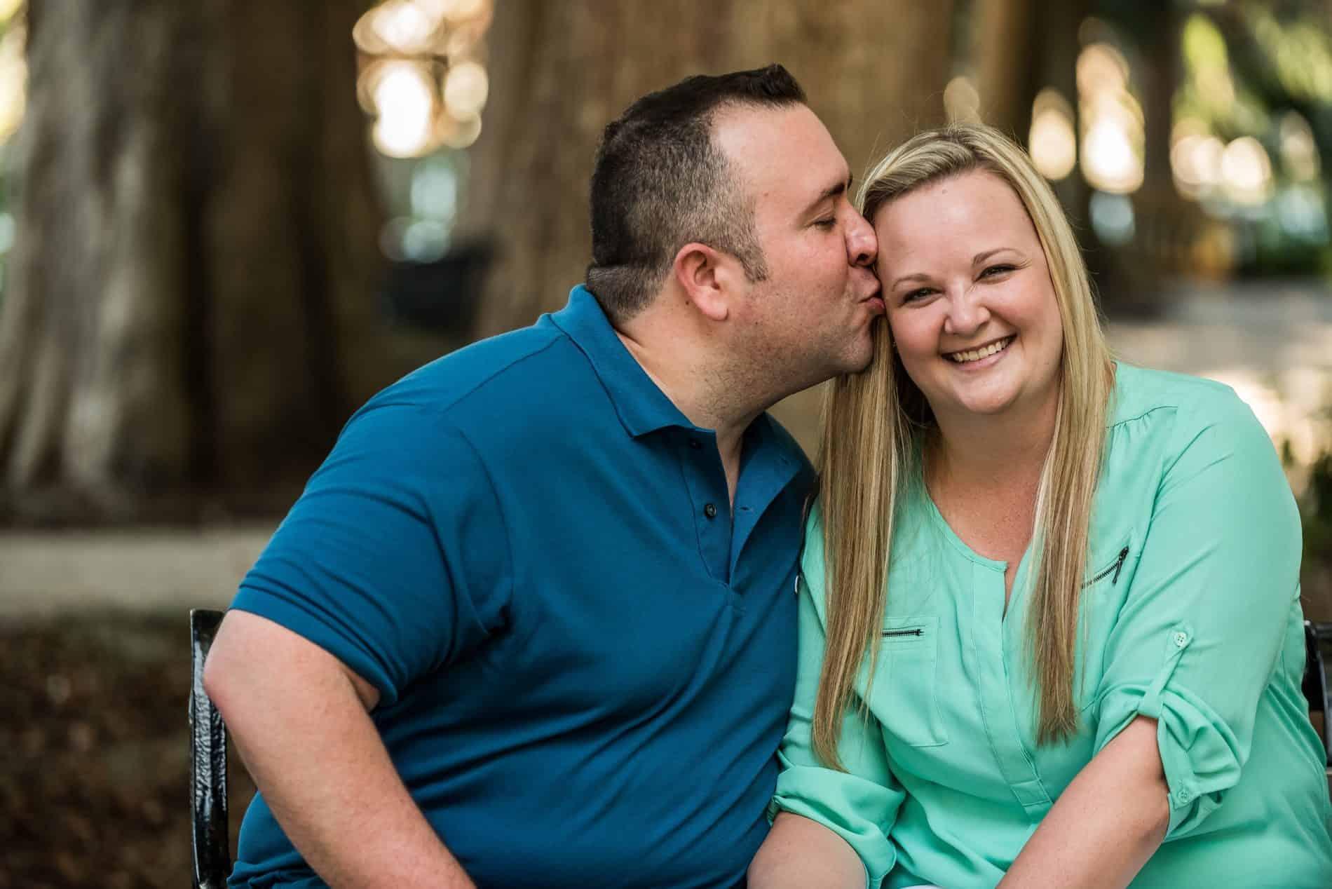 Groom kisses his bride in Kraft Azalea Garden