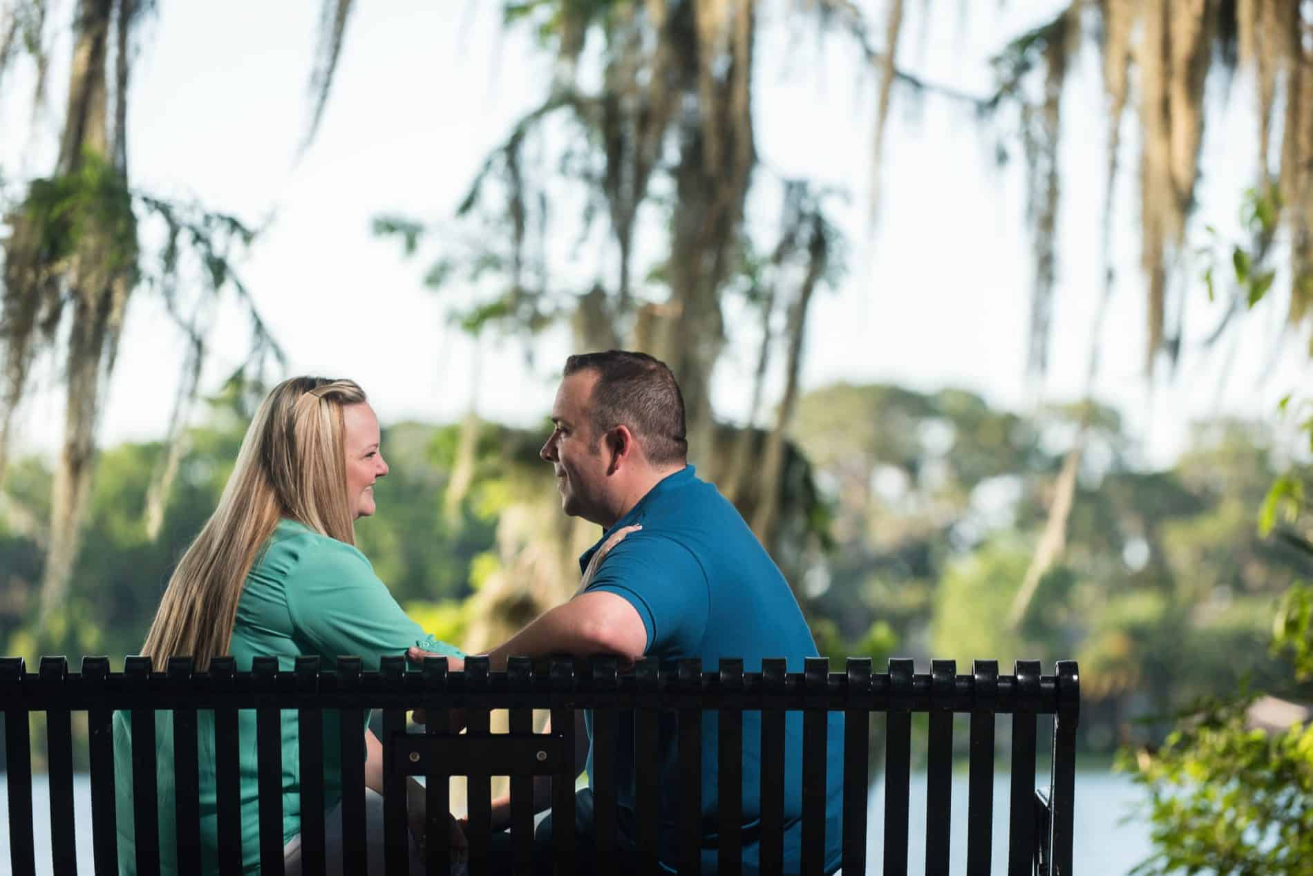 Smiling couple on a bench in Winter Park