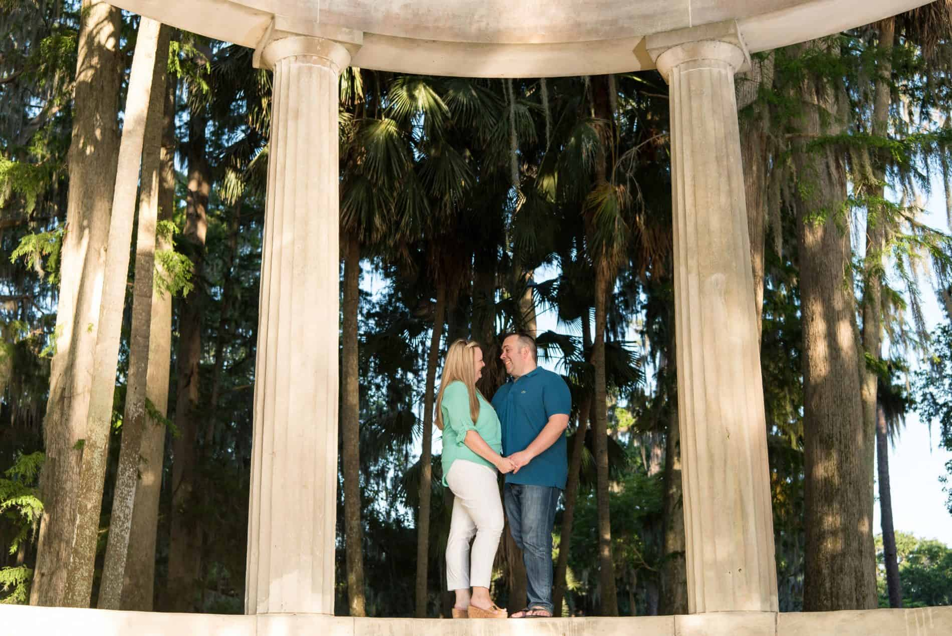 Couple standing under a gothic arch in winter park