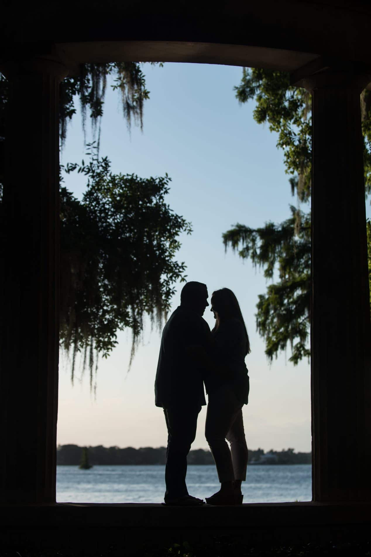 Gothic archway frame a photo of an engaged couple