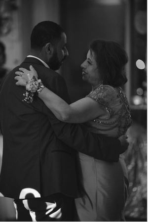 Mother and Son dance during an unplugged wedding