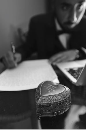 Writing a letter to his bride before his wedding