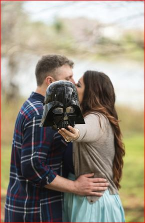 Kissing behind a Darth Vader mask