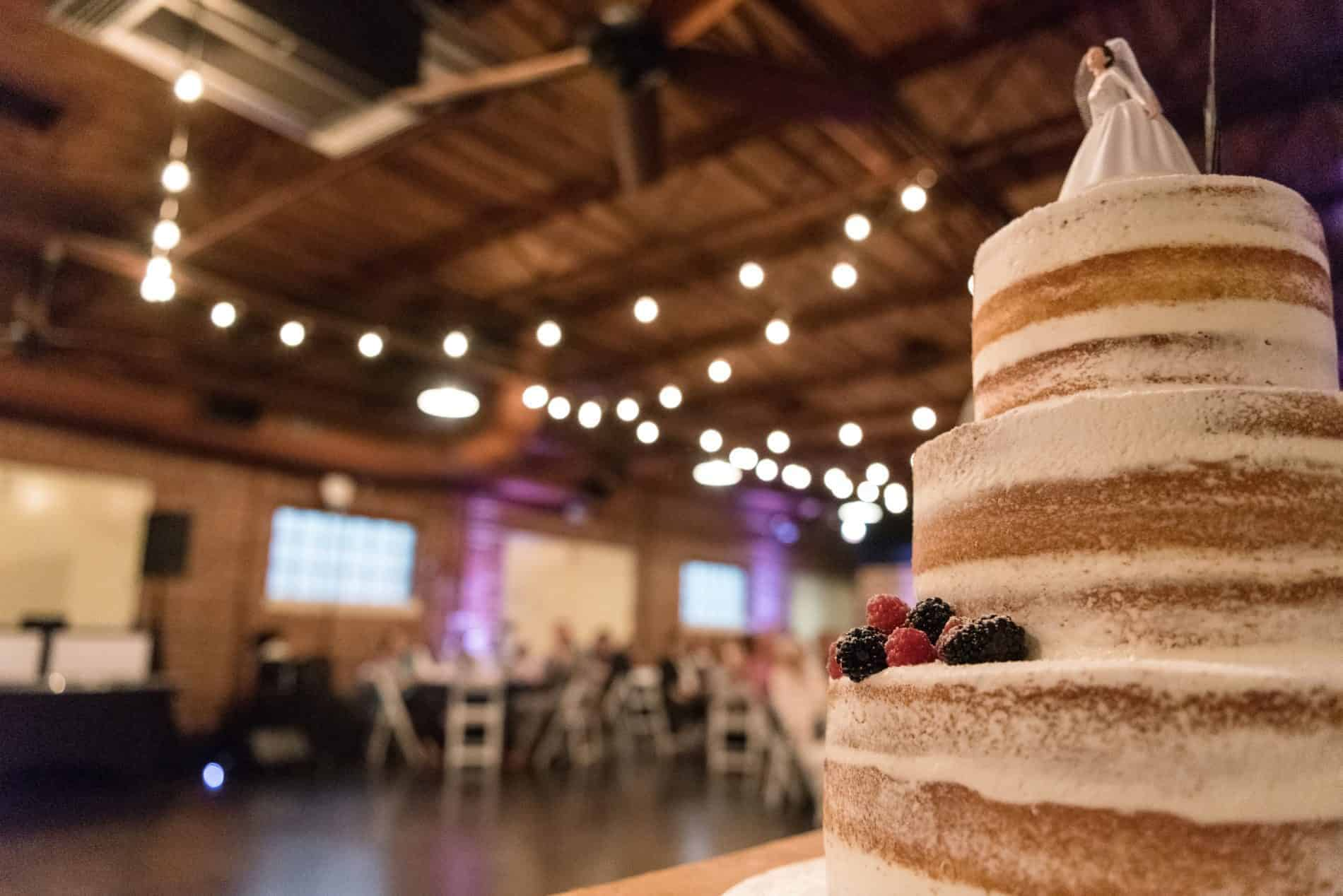 Beautiful naked Wedding Cake together with a Farmers Market Wedding Reception