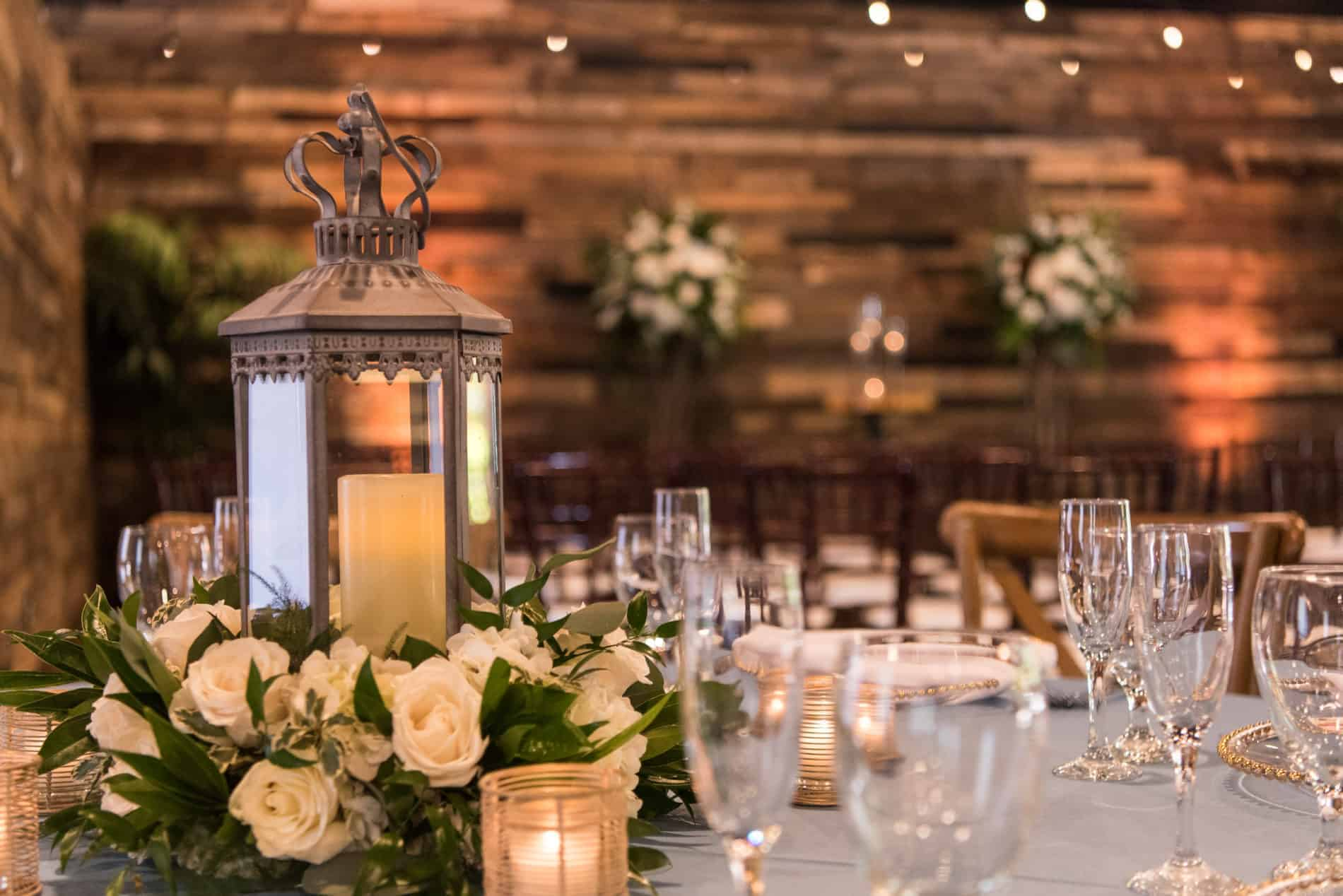 Rustic Lantern Centerpiece in detail on a Farm Table