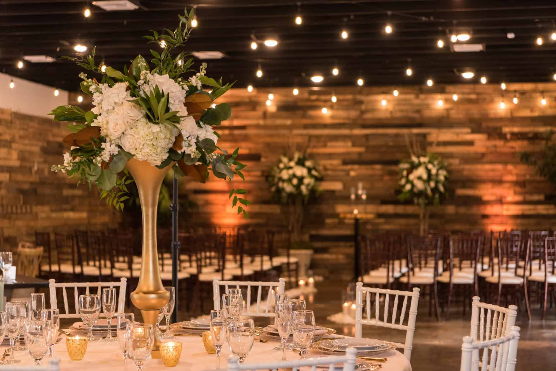 Reclaimed wood wall in a rustic reception setting