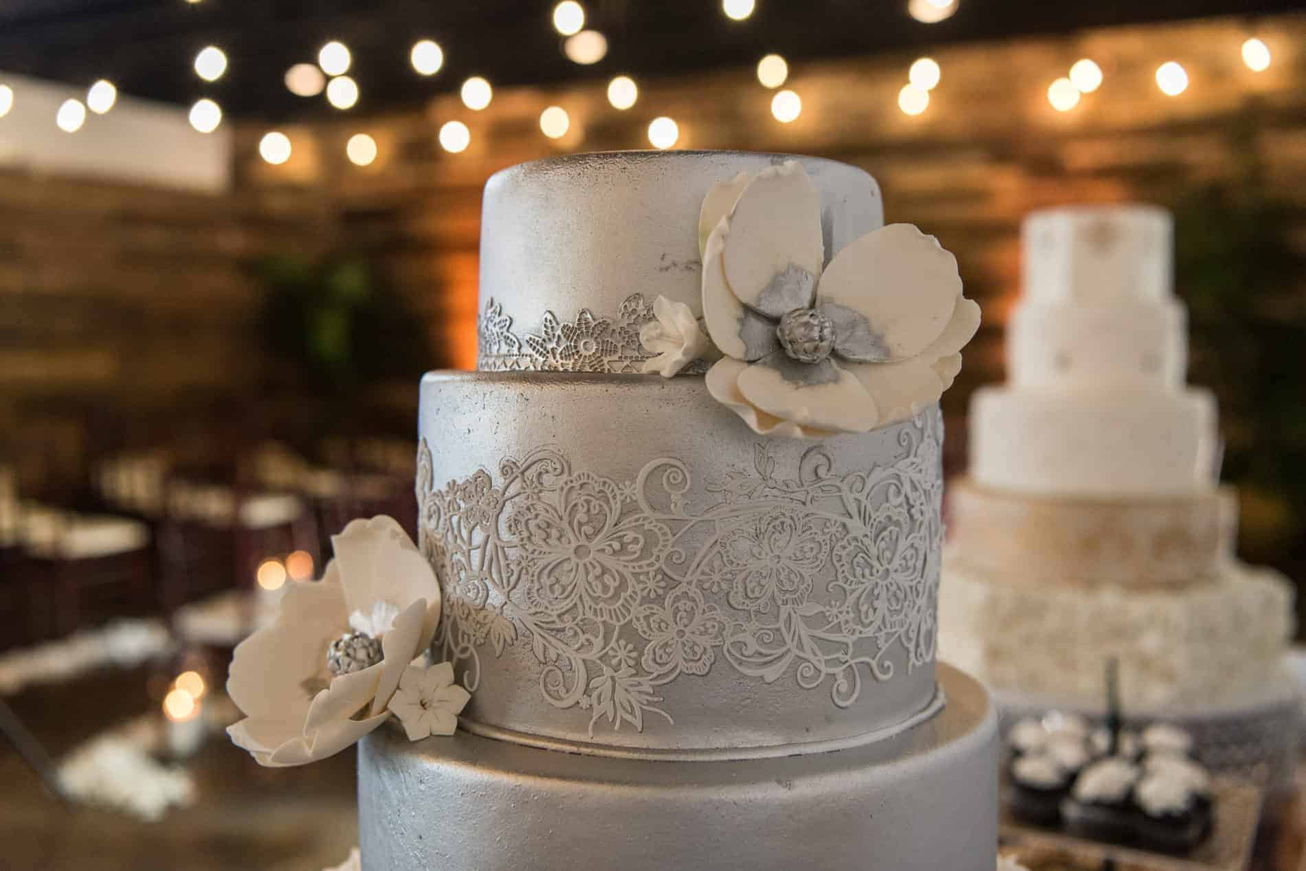 Beautiful Flora themed wedding cake in a rustic setting