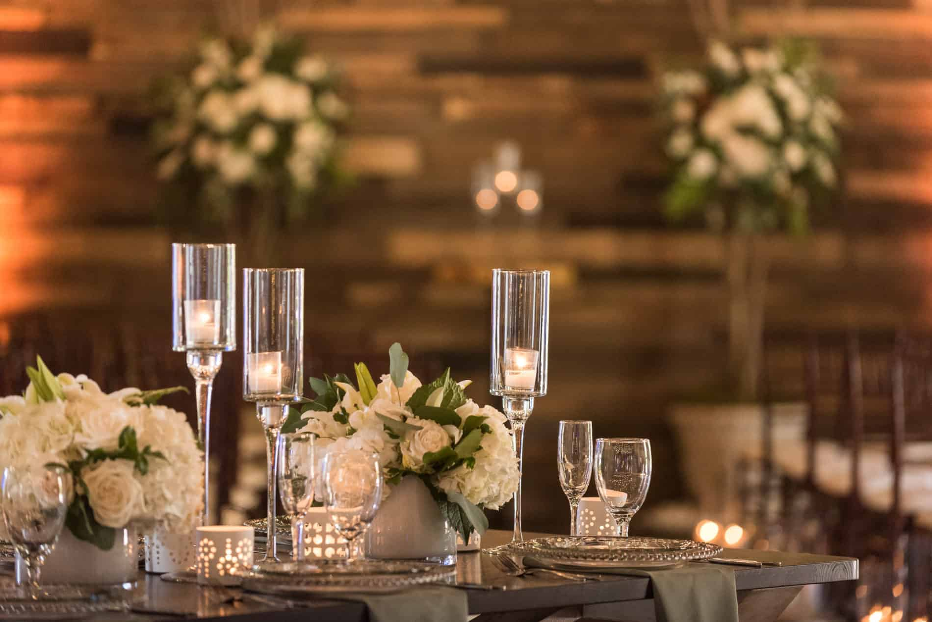 Green and White Centerpiece Ideas in contrast to a Rustic Farm Table