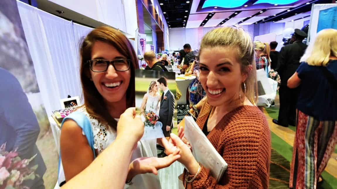 Two Sisters planning their weddings at an Expo