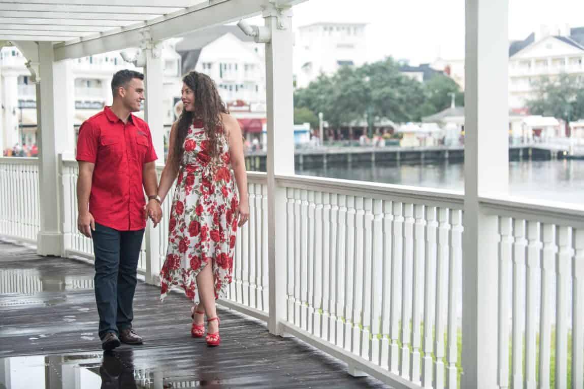 Cute Couple Enjoying Their Romantic Boardwalk Engagement Photos