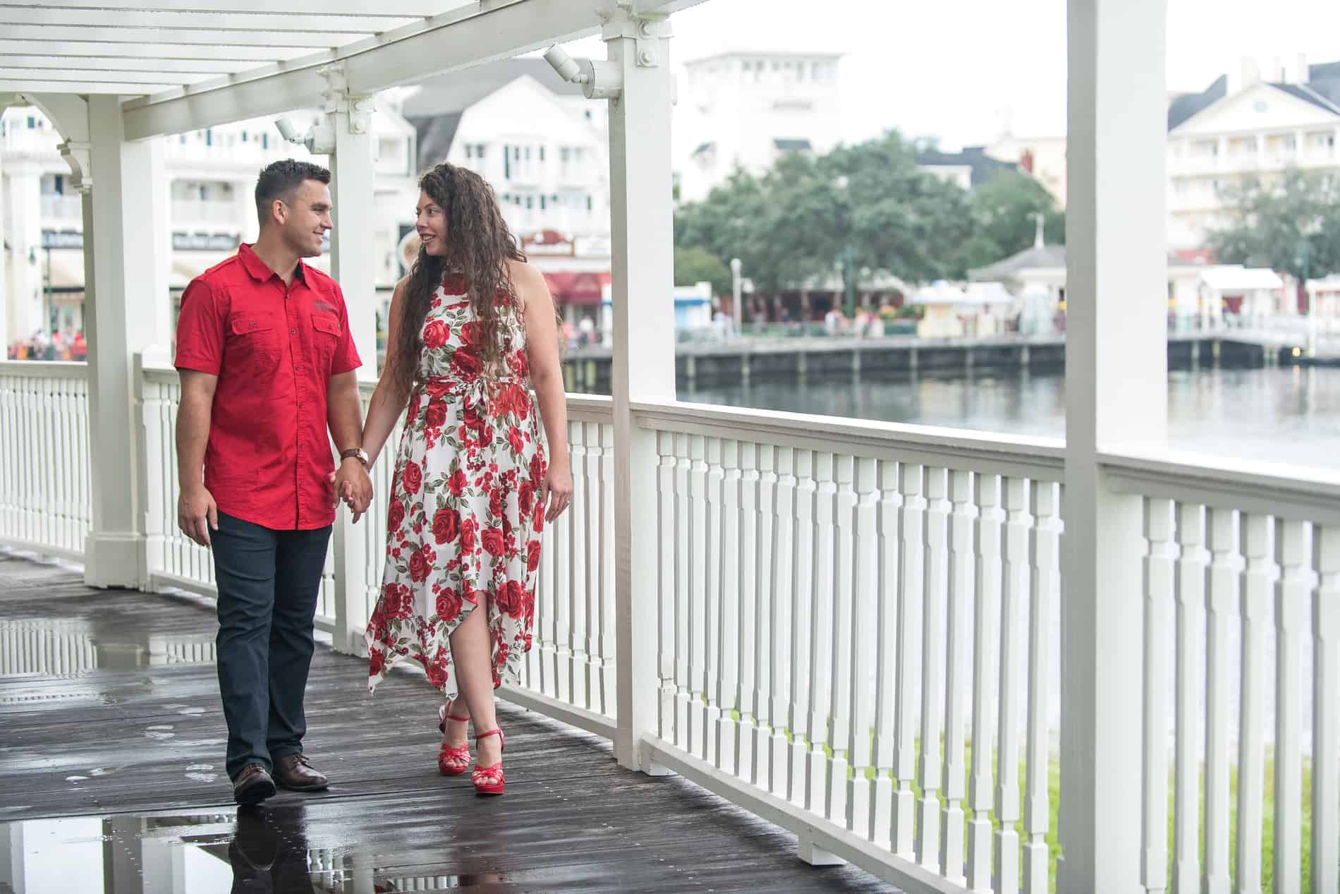 Cute Couple Enjoying Their Romantic Boardwalk Engagement Photos