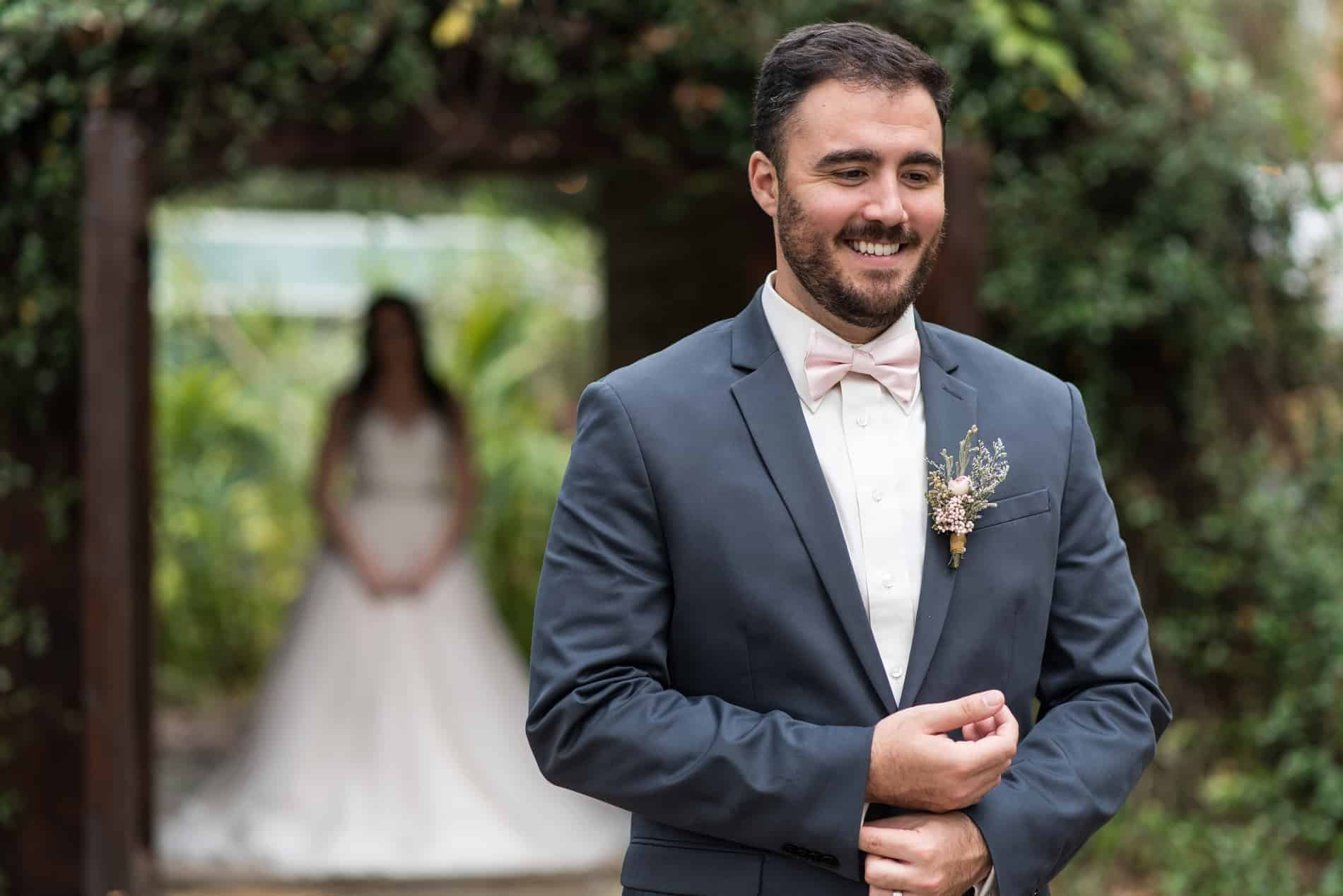 Bride and Groom enjoy their First Look at Harmony Gardens