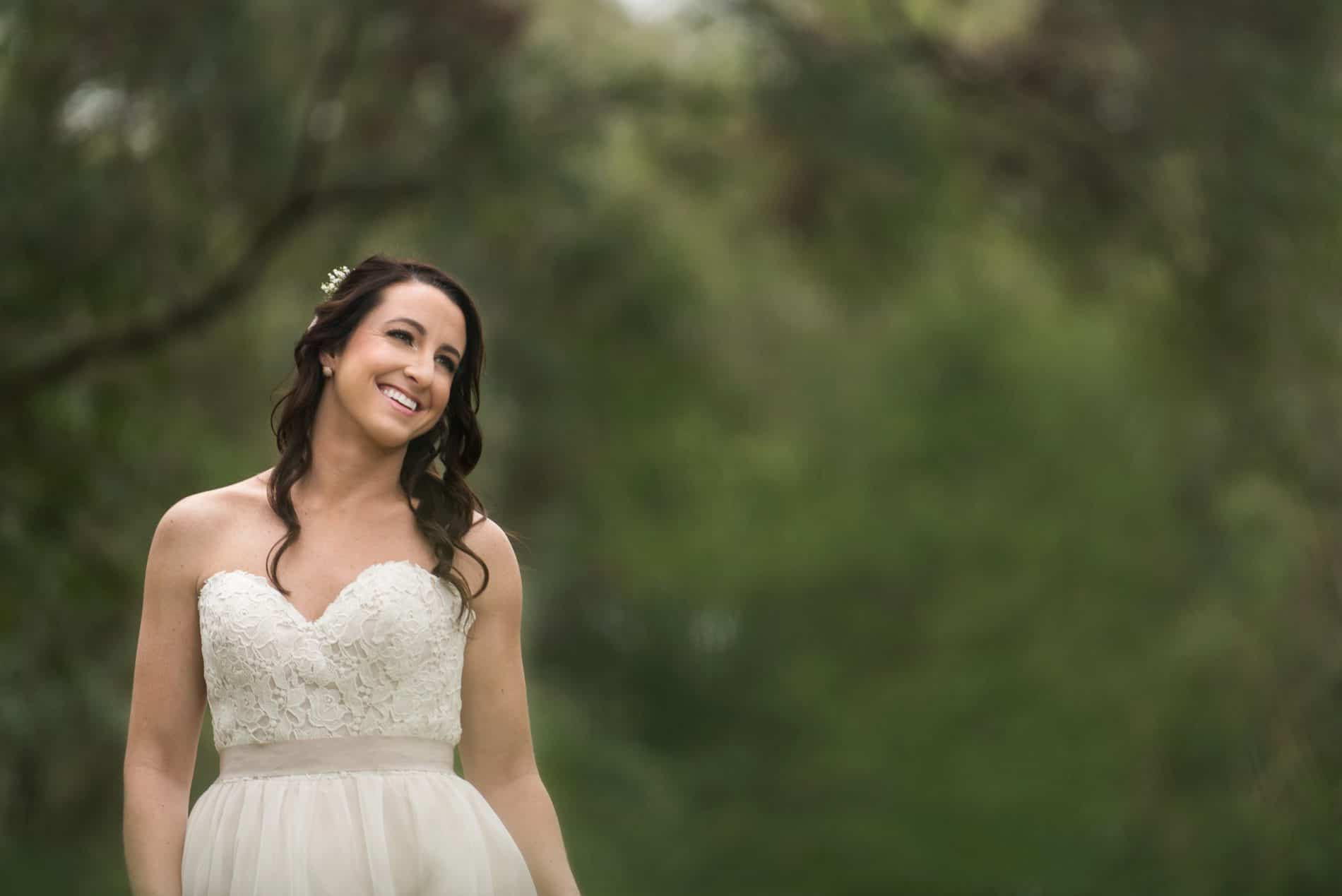 A Bride Posing among Harmony Gardens Fern Covered Grounds