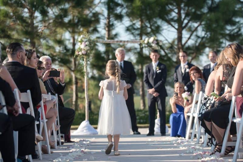 Super cute Flowergirl walks down the aisle at Waldorf Astoria